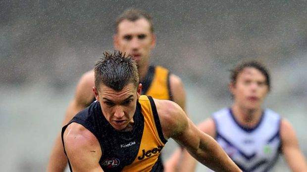Richmond's Dustin Martin tries to break a tackle during the loss to Fremantle.