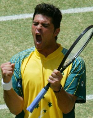 Winning ... Mark Philippoussis during his victory over Spain's Juan Carlos Ferrero in the 2003 Davis Cup final in Melbourne.