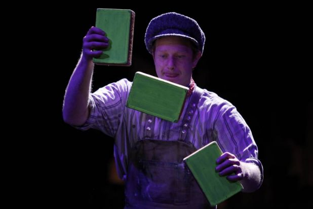 Performers use cigar boxes in a routine inspired by classic arcade games.