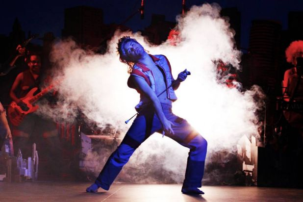 Air guitar is part of the repertoire for Circus Oz performers.