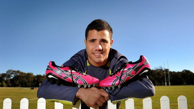 Bronson Harrison shows the pink boots he and David Shillington will wear against the Cowboys on Saturday.