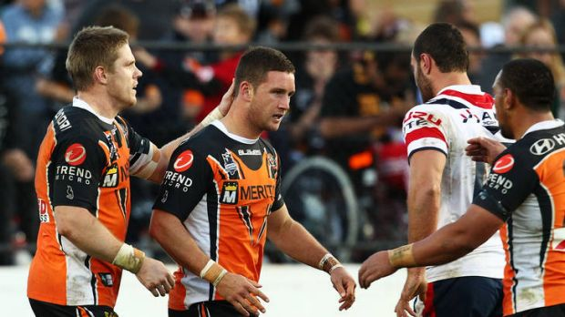 Tigers star Tim Moltzen, centre, is in the Raiders' sights.