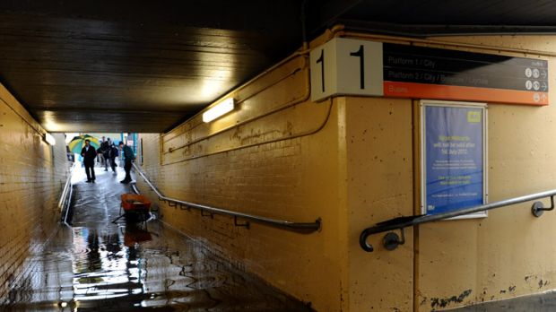 Commuters were seen removing their clothes to move between platforms via Blackburn station's flooded underpass.