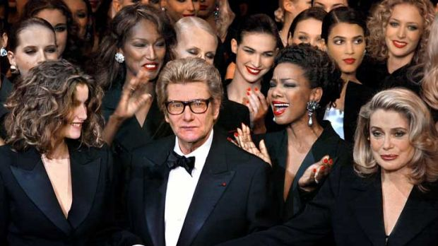 Yves Saint-Laurent took his final fashion bow in 2002 flanked by models and French actress Catherine Deneuve
