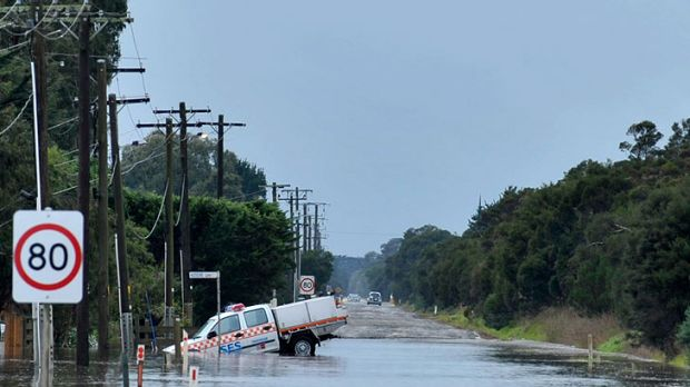 An SES vehicle in floodwaters at Koo Wee Rup this morning, where about 60 homes have been evacuated.