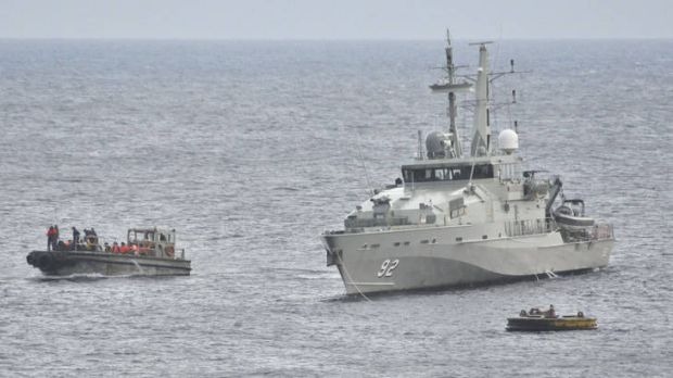 A Royal Australian Navy Ship takes part in a rescue effort of suspected asylum seekers after their boat capsized on June 22.