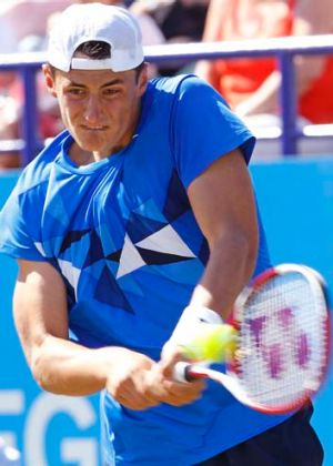 Bernard Tomic plays Fabio Fognini of Italy during the Eastbourne tournament.
