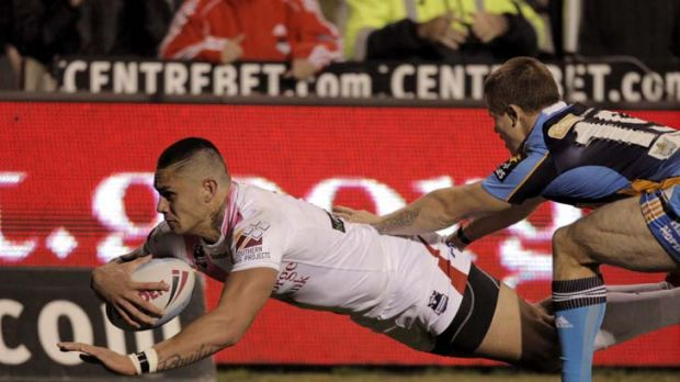 The big four ... Daniel Vidot scores the Dragons' only try.