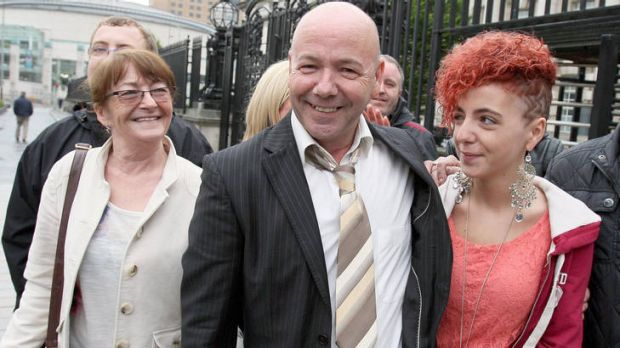 Liam Holden, now 58, with family outside the Court of Appeal in Belfast.