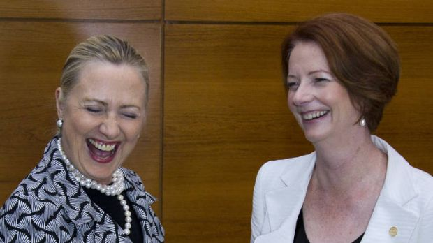 US Secretary of State Hillary Clinton and Prime Minister Julia Gillard find something to laugh about on the sidelines of ...