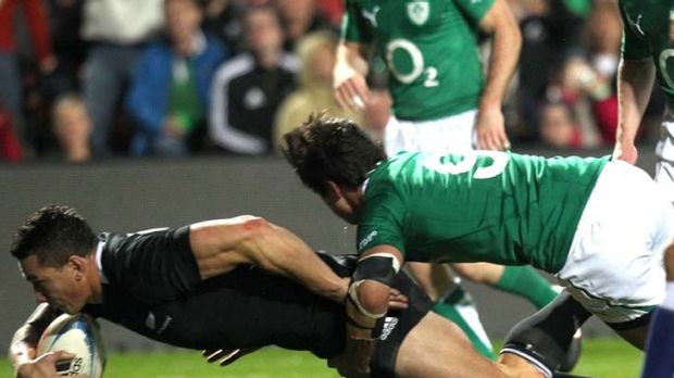 Try ... Sonny Bill Williams of New Zealand scores as he is tackled by Conor Murray of Ireland.