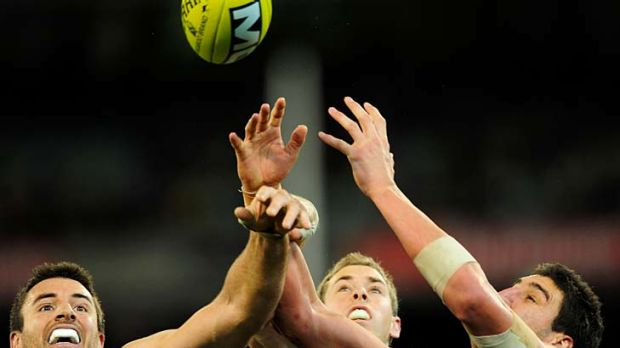 Collingwood's Darren Jolly and Nick Maxwell battle with Eagle Dean Cox.