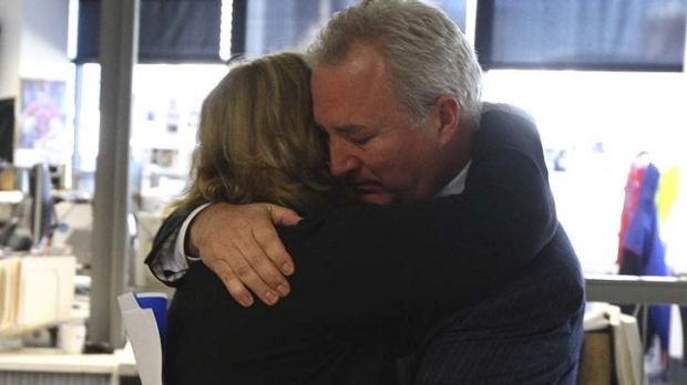 Leaving together ... Peter Fray hugs Amanda Wilson after their announcements to staff today.