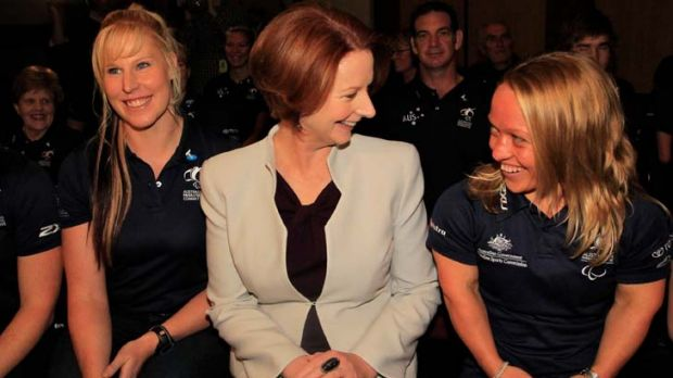 Whatever else, a good sport … Julia Gillard at the announcement of the Australian Paralympic team yesterday. She ...