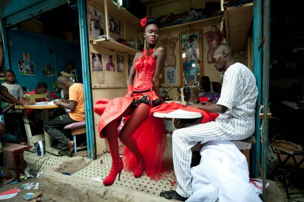 World Press - 2nd prize Arts and Entertainment Singles. A model poses in front of a tailor's stall in the center of ...