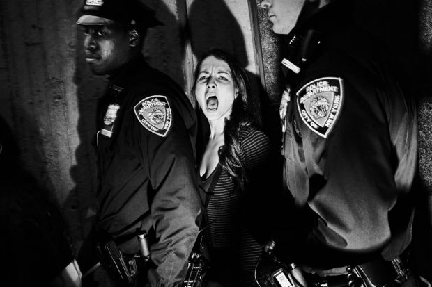 World Press - 2nd prize People in the News Singles. A protester is arrested during demonstrations against police ...