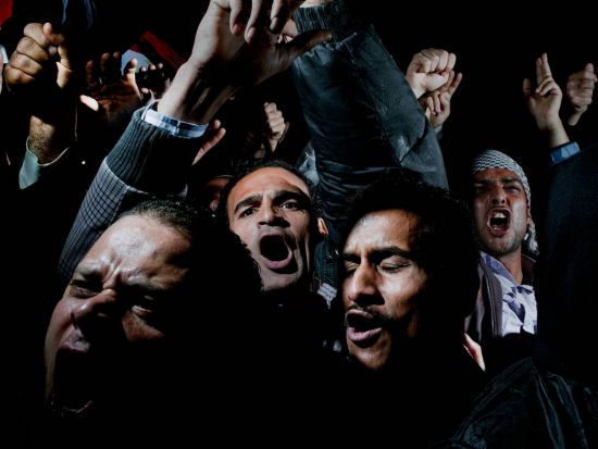 World Press - 1st prize General News Singles. Demonstrators on Tahrir Square, Cairo, react to a televised speech, in ...
