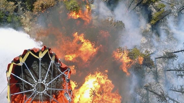 Water bombs away: A Bambi water bucket dumping its contents on a hot spot in the High Park fire.