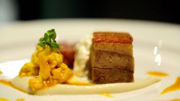 Pork-hock terrine and caramelised pork belly served with celeriac puree, piccalilli and sauce gribiche.