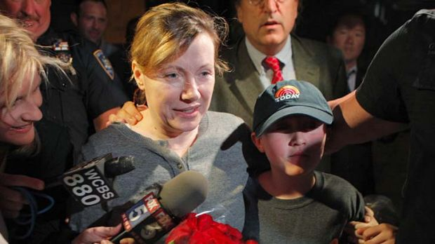 Reunited with her family ... Anna Gristina stands with her son as she addresses the media.