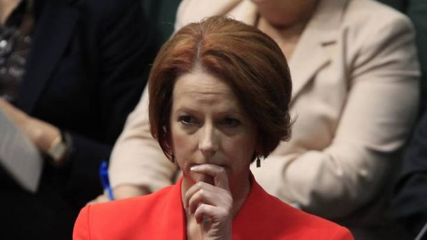 Prime Minister Julia Gillard listens to Liberal MP Michael Keenan speak during the debate about the Oakeshott  asylum ...