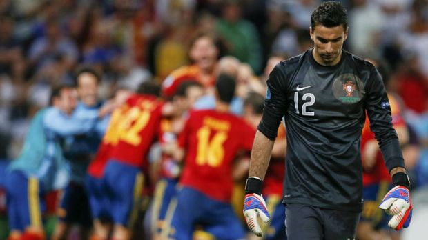 Portugal's goalkeeper Rui Patricio walks off the pitch as Spain's team celebrates its penalty shooout win in the ...