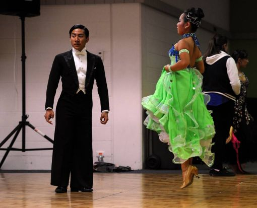 In the warm up room, competitors in the Adult category, Ryutaro-Louie Hirose and partner Marina Hirose from Queensland.