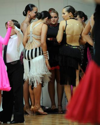 Dancers gather for a chat in the warm up room before heading to the dance floor.