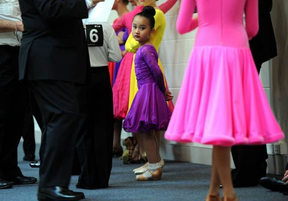 A competitor in the Juvenile category,  Ashley Huynh from Victoria, waits patiently in the warm up room.