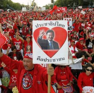 Loyalists of billionaire Thaksin Shinawatra rally for their ousted leader's return.