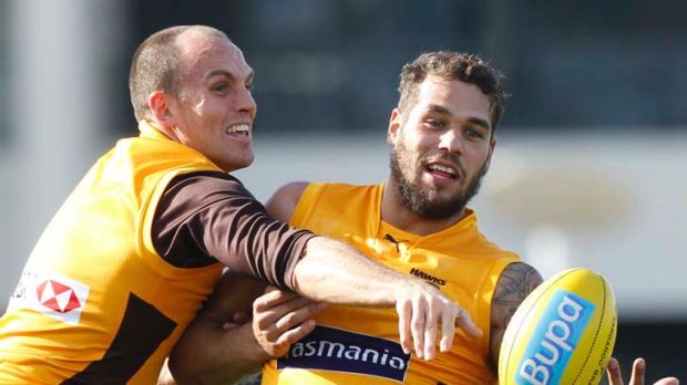 Take that: Cameron Bruce spoils a hirsute Buddy Franklin at training.