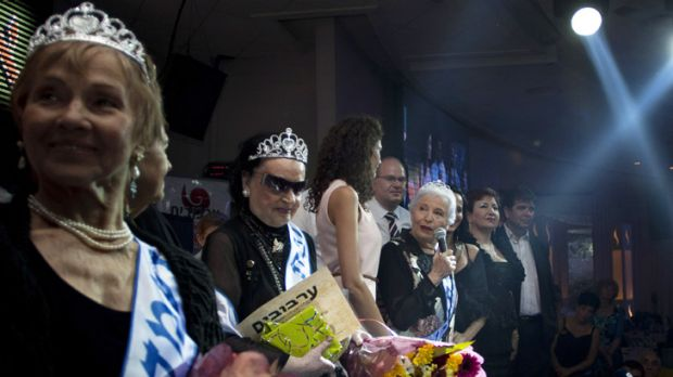 Hava Hershkovitz, third from right, speaks to the crowd after her win.