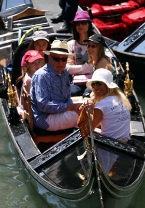 Family holiday ... Rupert Murdoch takes his wife, Wendi, top, and children Grace and Chloe, left, on a gondola ride in ...