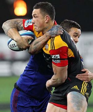 Back in business ... Sonny Bill Williams offloads in the tackle of Tamati Ellison.