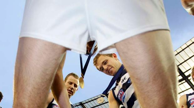 Before the dam wall broke: The Cats celebrate their 2011 grand final victory over Collingwood.