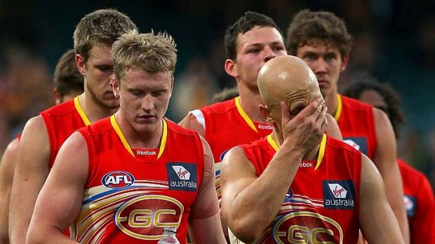 Dejected: Gary Ablett leads the Suns off the ground yesterday.