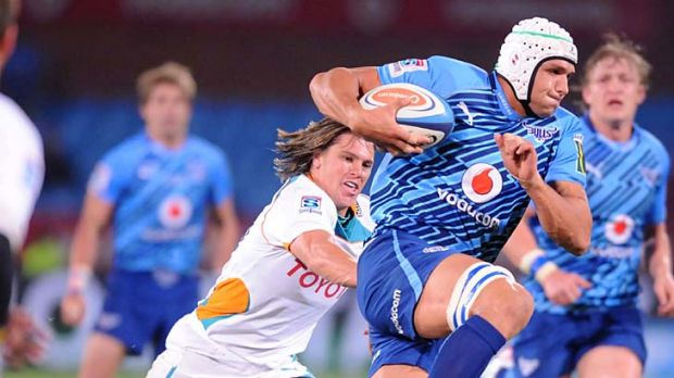 Juandre Kruger of the Bulls skips clear of the Cheetahs' defence.