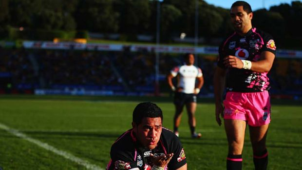 Konrad Hurrell of the Warriors celebrates after scoring a try.