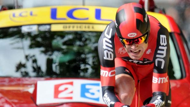 In the red … the effort shows on the face of Cadel Evans during the 6.4-kilometre time trial.