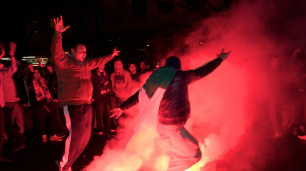 Italy fans set off flares on Lygon Street.