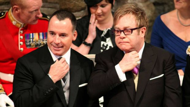 Title in the wings ... Sir Elton John, right, with his partner, David Furnish, at the royal wedding last year.