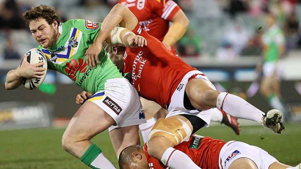 Shaun Fensom tries to break out of the tackle.