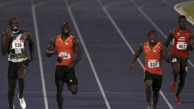 New order … Yohan Blake, second from right, eases ahead of Usain Bolt, left, in the 200m final at the Jamaican ...