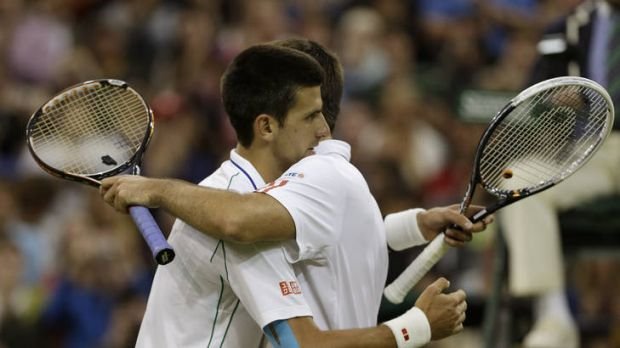 Novak Djokovic of Serbia, (left) embraces friend and countryman Viktor Troicki after their Wimbledon clash.