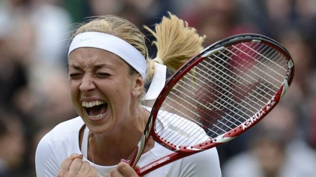 Sabine Lisicki of Germany celebrates after defeating Maria Sharapova of Russia at Wimbledon.