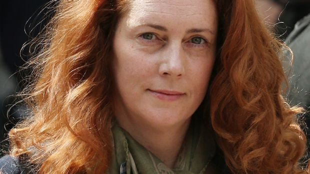 Straight-laced ... Rebekah Brooks tames her mane for court.