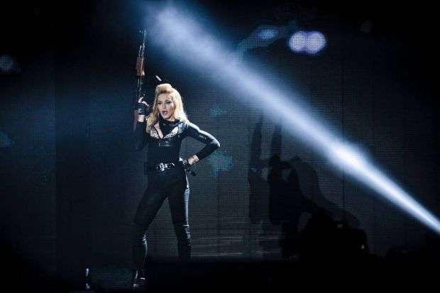US pop singer Madonna performs on July 2, 2012 during a concert of her MDNA world tour at Parken in Copenhagen.
