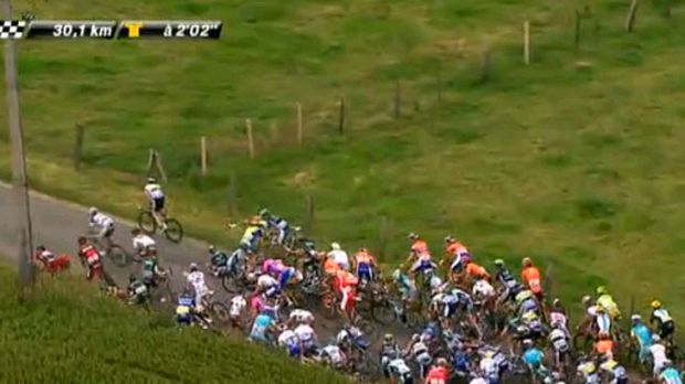 Domino effect ... More riders fall at the 140km mark.