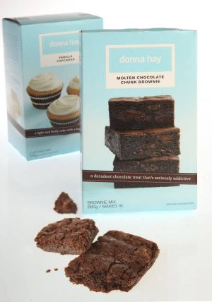 Hay has built herself a culinary empire... pictured are Donna Hay Molten Chocolate Chunk Brownie and Vanilla Cupcake kits.