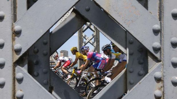 Mellow yellow ... Fabian Cancellara, in the Tour leader's jersey, rides with the pack during the 214.5km fourth stage ...